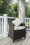 Outdoor Decor - Patio Chair with Pillows Stock Images