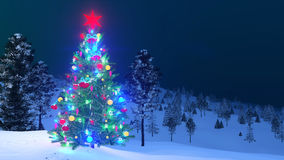 Outdoor decorated Christmas tree at night Stock Photography