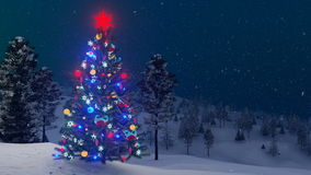 Outdoor decorated Christmas tree at snowfall night