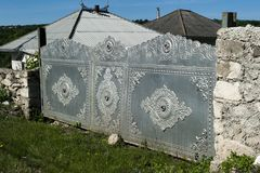 Outdoor decorated gate. Classic Moldavian gate from outside, decorated and handcrafted, in countryside Moldova near city Fetesti royalty free stock photos