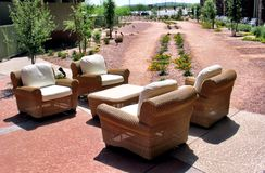 Outdoor Desert Garden Seating. Outdoor chairs in an arid but pleasant-looking desert garden on a bright sunny day Stock Photos