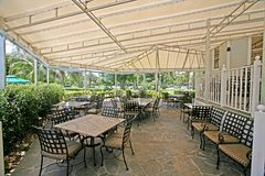 Outdoor Dining. A photo of an empty outdoor dining patio.  Taken in Southwest Florida Royalty Free Stock Photography