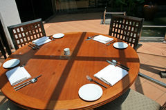 Outdoor dining. Wooden table Royalty Free Stock Photos
