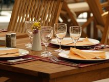 Outdoor dining. Table set in outdoor restaurant Royalty Free Stock Photos