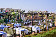 Outdoor dining area at a tropical hotel Stock Image