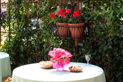 Outdoor Dining with Flowers Royalty Free Stock Images
