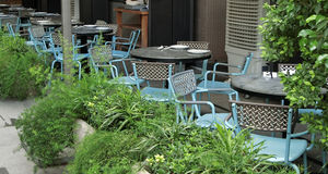 Outdoor Dining. Hong Kong - July 2016   Setting for outdoor dining at a cafe in Hong Kong among greenery Stock Images