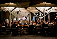Outdoor Dining in London. People enjoy dinner in an outdoor restaurant in Covent Garden in London on August 16, 2013. The Covent Garden area has over 60 Stock Images