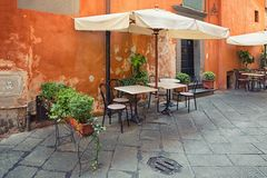 Outdoor dining nook in Tuscany Royalty Free Stock Image