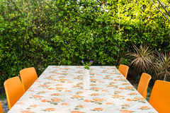 Outdoor dining table Stock Images