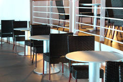 Outdoor dining. Tables and chairs on deck of cruise ship at night Stock Images