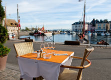 Outdoor dinner setting in Honfleur, France Royalty Free Stock Photos