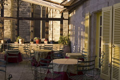 Outdoor Dinning in Avignon. The outside patio to a three star restaurant in Avignon, France Royalty Free Stock Image