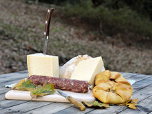 Outdoor eating with bread, cheese and sausage. Stock Photo