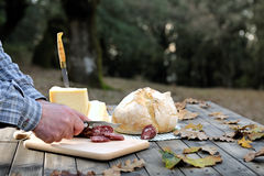 Outdoor eating with bread, cheese and sausage. Royalty Free Stock Photography