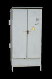 Outdoor electric control grey cabinet with sign electrical hazard isolated on black.  stock photography