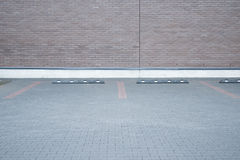 Outdoor empty space car parking and modern brick wall stock photography