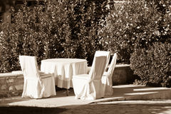 Outdoor empty summer cafe table with chairs Royalty Free Stock Images