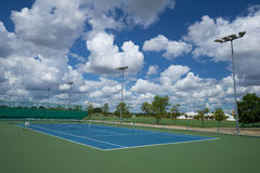 Outdoor empty tennis court with blue sky Royalty Free Stock Photos