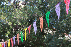 Outdoor event streamers. Line of hanging decorative streamers at an outdoor event stock photo