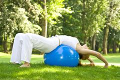 Outdoor exercise. Fitness girl outdoor exercise by Pilate's ball royalty free stock photography