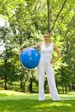 Outdoor exercise. Fitness girl outdoor exercise by Pilate's ball royalty free stock photos