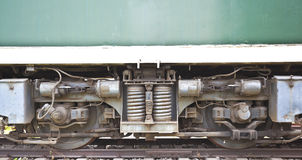 Outdoor exhibition of old trains chassis close-up Stock Photos