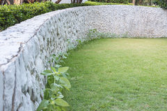 Outdoor exterior stone wall decorative in the garden Stock Image