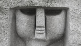 Outdoor face of stone statue in park Royalty Free Stock Photo