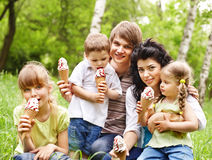 Outdoor family with kids on green grass. Royalty Free Stock Photo