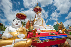 Outdoor of famous large sitting Buddha in Thai Temple. Royalty Free Stock Image