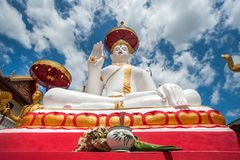 Outdoor of famous large sitting Buddha in Thai Temple. Stock Photo