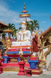 Outdoor of famous large sitting Buddha in Thai Temple. Royalty Free Stock Photography