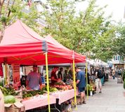 Outdoor farmer`s market selling fruit and vegetables under tents stock photo