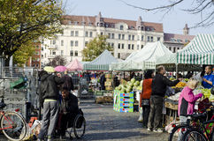 Outdoor farmers market, people buying food. Farmers market day outdoors with a bunch of people fruit and vegetable sellers. A lively scene with much expressions royalty free stock image