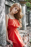 Outdoor fashion beautiful young woman photo near old HOMESTEAD summer. Portrait girl blondes in red dress. Royalty Free Stock Images
