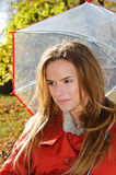 Outdoor fashion close up portrait of young beautiful sensual woman in Autumn park with umbrella Stock Photos