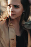 Outdoor fashion closeup portrait of young pretty woman Stock Photography