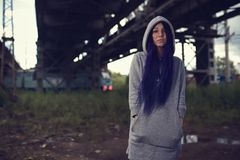 Outdoor fashion lifestyle portrait of pretty young girl, wearing in hipster swag grunge style with violet hair urban background Royalty Free Stock Photo