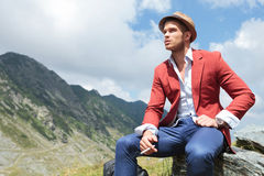 Outdoor fashion man looks away, smoking Royalty Free Stock Photo