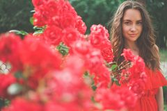 Beautiful young woman surrounded by flowers. Outdoor fashion photo of beautiful young woman surrounded by flowers. Spring blossom Royalty Free Stock Images