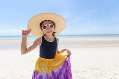 Outdoor fashion photo of cute happy girl at sea,beach travel royalty free stock photography