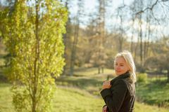 Outdoor fashion photo of young beautiful lady in a birch forest. stock images