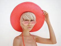Beautiful lady in red hat and sunglasses. Outdoor fashion photo of young beautiful lady in red hat and sunglasses. Summer Beach travel. Summer vibes Royalty Free Stock Photos