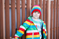 Outdoor fashion portrait of adorable little kid boy wearing colorful clothes. Spring, summer or autumn fashion for boys and children. Boy with tooth gap stock image
