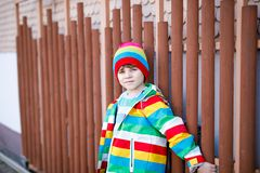 Outdoor fashion portrait of adorable little kid boy wearing colorful clothes. Spring, summer or autumn fashion for boys. And children. Boy with tooth gap stock photography