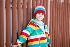 Outdoor fashion portrait of adorable little kid boy wearing colorful clothes. Spring, summer or autumn fashion for boys. And children. Boy with tooth gap royalty free stock images