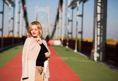 Outdoor fashion portrait of attractive model in autumn casual ap. Outdoor fashion portrait of attractive woman in autumn casual apparel walking in the city Royalty Free Stock Photo