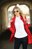 Outdoor fashion portrait of beautiful blonde woman wearing sunglasses.  royalty free stock image