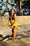 Outdoor fashion portrait of beautiful tanned woman on the beach Royalty Free Stock Photography